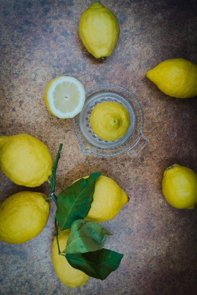 Fresh lemons and lemon juice