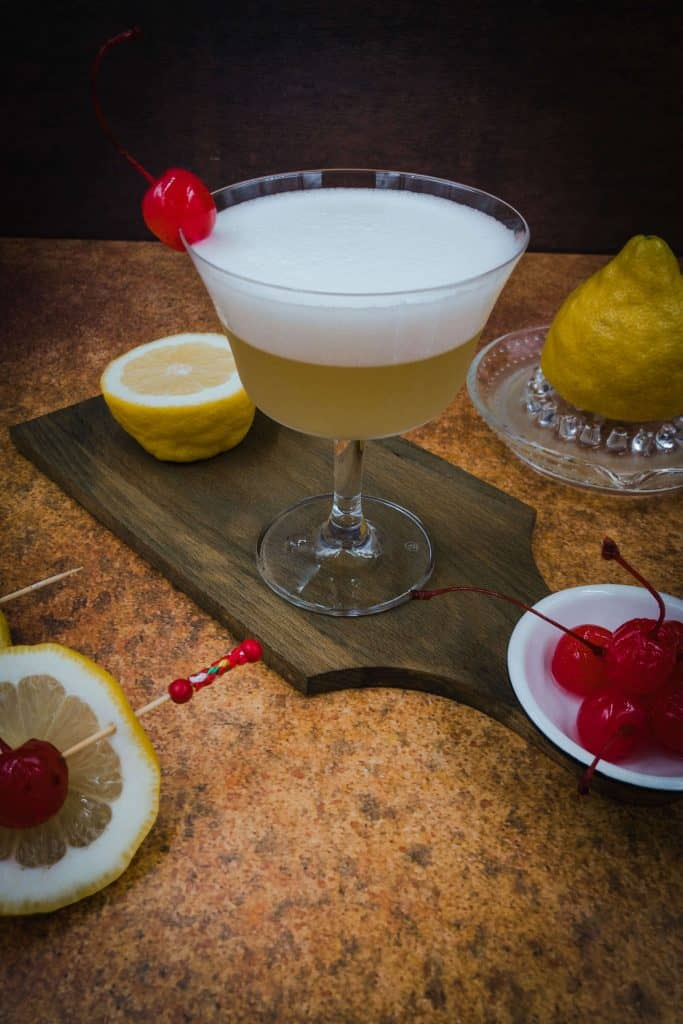 A delicious non alcoholic whiskey sour with a cherry