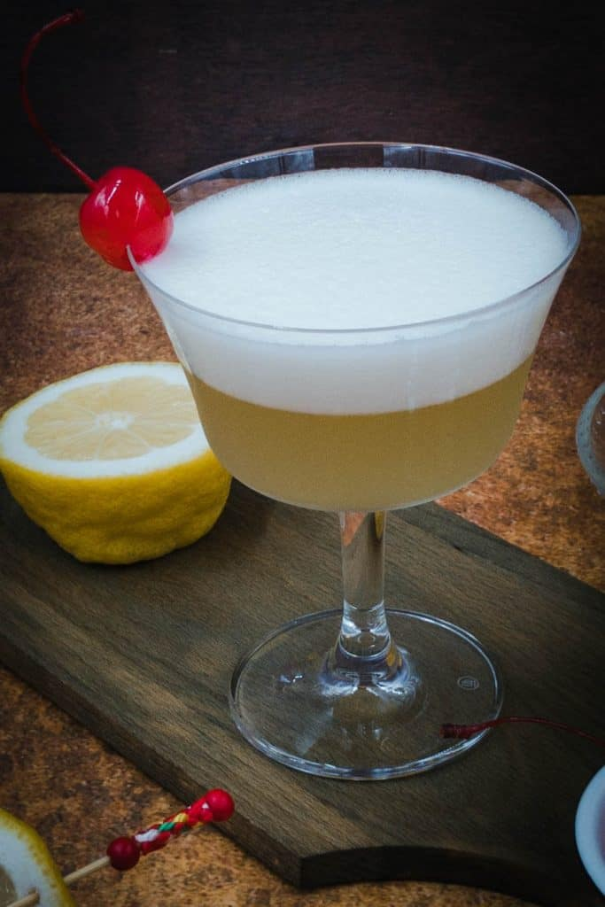 Stunning whiskey sour mocktail with a cherry
