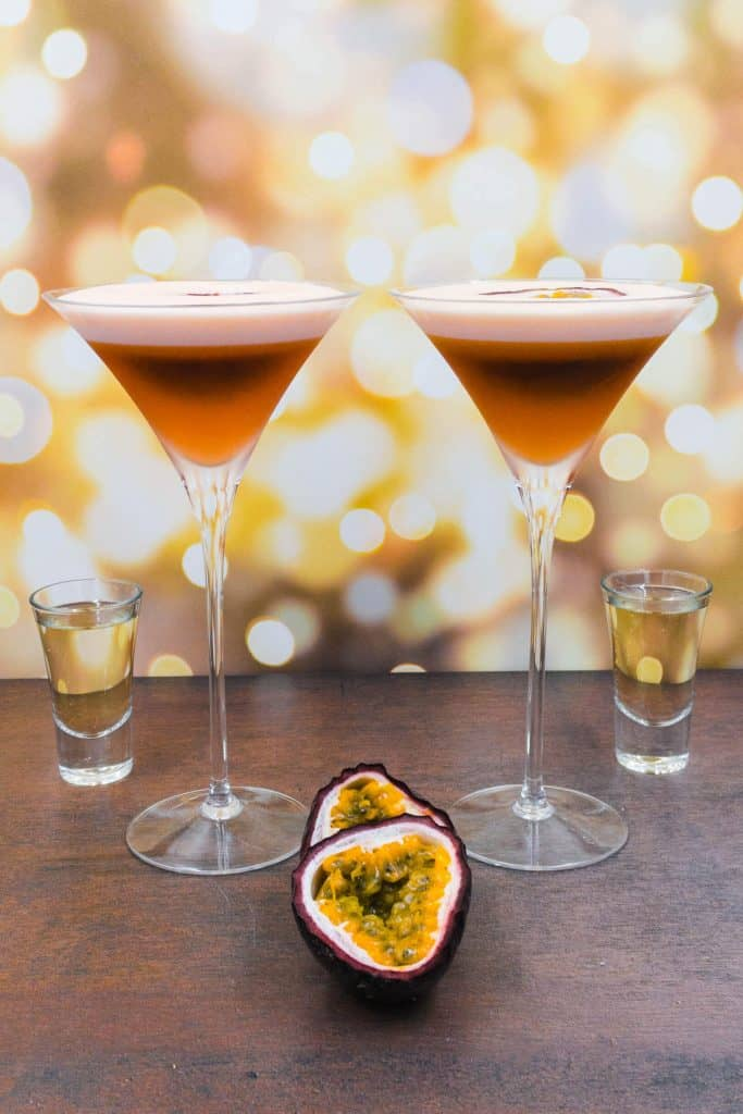 Two stunning porn star martini cocktails with zero alcohol, alcohol free champagne substitute and fresh passion fruits